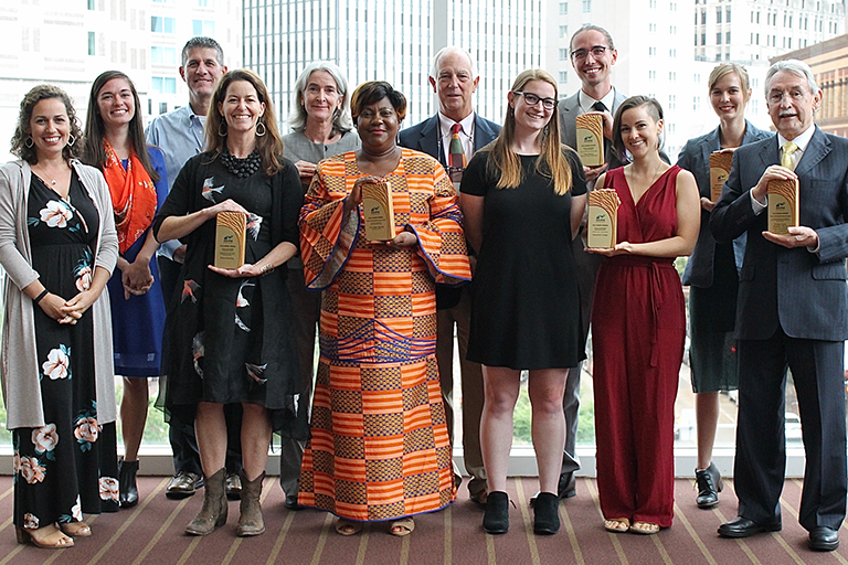 Group of AASHE 2018 Award Winners Posing with Plaques